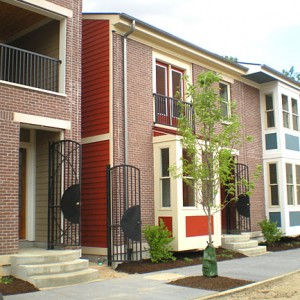 Image of a red brick row house.